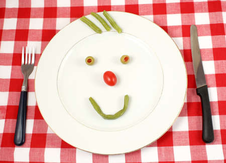 green beans and grape tomato in the shape of a happy face photo