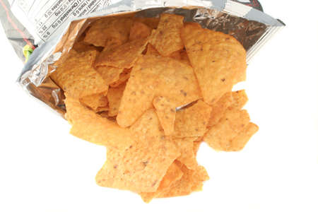opened bag: opened bag of tortilla chips spilling out