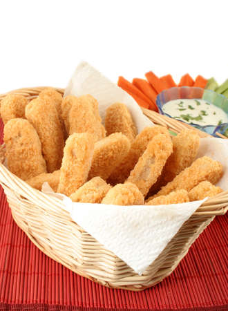 basket of crispy chicken fingers with platter of vegetables and dip Stock Photo - 616587