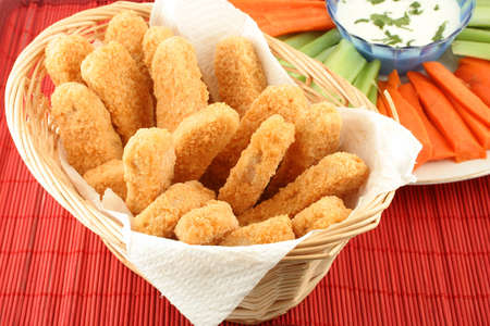 basket of crispy chicken fingers with platter of vegetables and dip Stock Photo - 616588