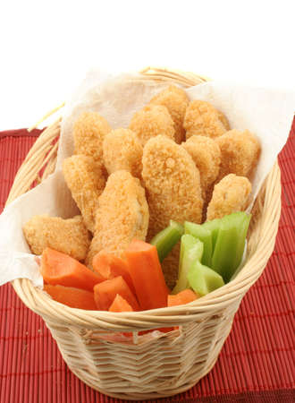 basket of crispy chicken fingers with platter of vegetables and dip Stock Photo - 616591