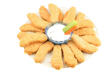 plate of crispy chicken fingers with  vegetables and dip Stock Photo - 616592