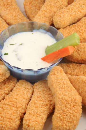 plate of crispy chicken fingers with  vegetables and dip Stock Photo - 615890