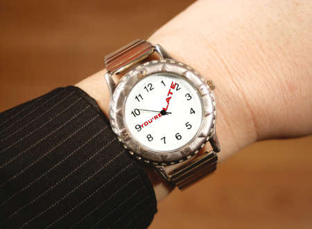 tardiness: watch tells businessperson that theyre late for work