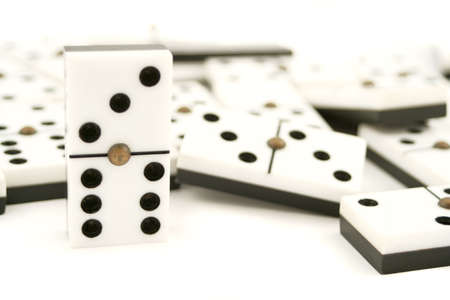 lined up white dominoes with black dots