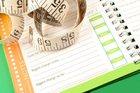 a measuring tape, diet and nutrition journal Stock Photo - 638310