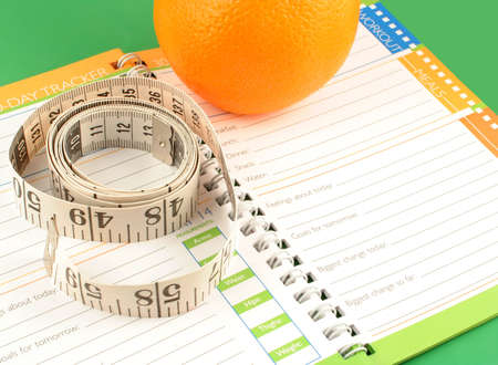 a measuring tape, diet and nutrition journal