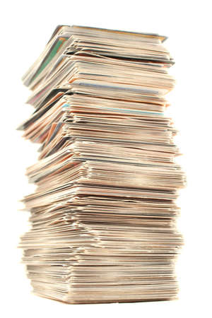 a piled up tall stack of collector's playing cards