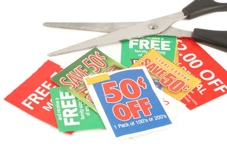 coupons: clipping coupons to save money at the grocery store