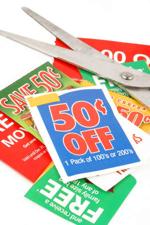 clipping coupons to save money at the grocery store
