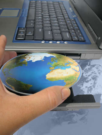 hand inserting the world into a computer