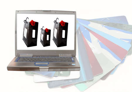 computer with images of shopping bags and credit cards in background Stock Photo - 659618