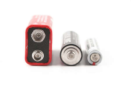 three different sized batteries with varied volt currencies