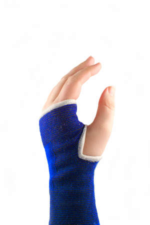 hurting: sprained wrist wrapped in a elastic cloth for support