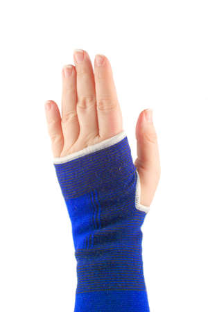 sprained: sprained wrist wrapped in a elastic cloth for support