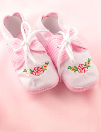 appropriate: little  girls pink booties appropriate for newborn Stock Photo