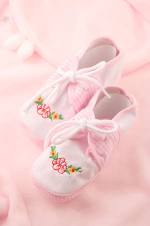 garb: little  girls pink booties appropriate for newborn Stock Photo