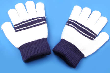 wooly: warm, wooly winter mittens on purple background