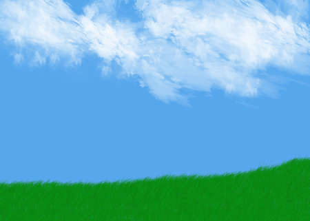 green grass against a beautiful blue cloudy sky Stock Photo