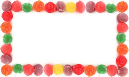 Arco iris de colores diversos dulces duros lollipop frontera o marco Foto de archivo - 701639