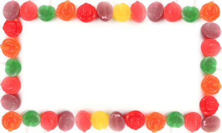 candy border: various rainbow colored  hard lollipop candy border or frame Stock Photo