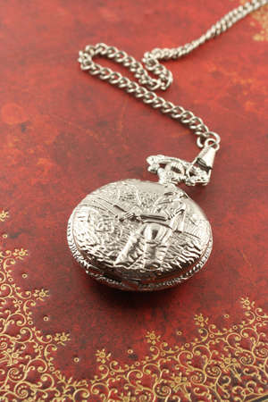 antique silver  pocket watch with ornate relief design Stock Photo