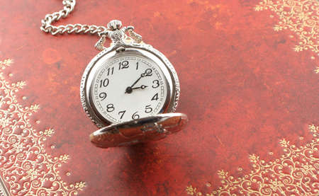 heirlooms: antique silver  pocket watch with ornate relief design Stock Photo