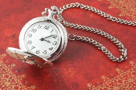 priceless: antique silver  pocket watch with ornate relief design Stock Photo