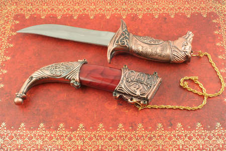 decorative asian knife with horses head and shield