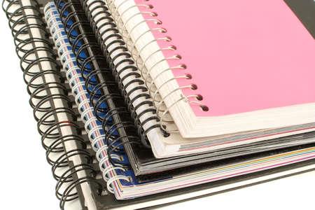 leger: a pile of metal ring binder notebooks