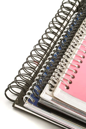 a pile of metal ring binder notebooks photo