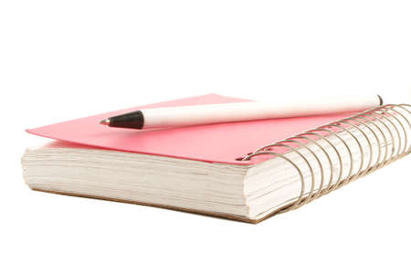 educational tools: pink covered metal ring binder notebook and pen Stock Photo