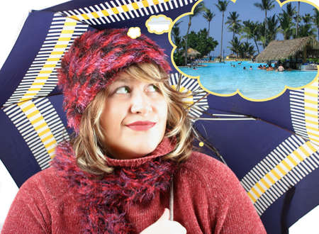 unhappy woman  not content with the rainy weather while day dreaming of Caribbean photo