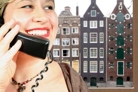 woman makes an international phone call in Amsterdam photo