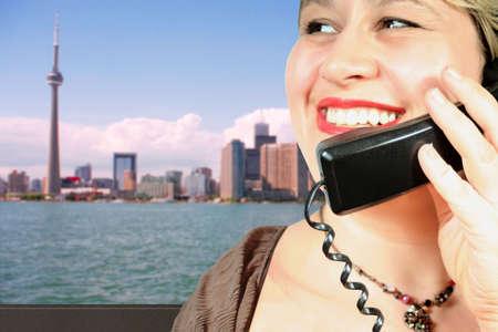 woman makes an international call in Toronto photo