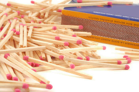 piled up unused wooden match sticks and box
