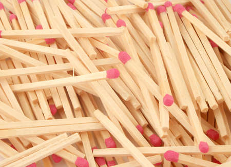 piled up unused wooden match sticks and box photo