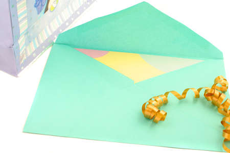 isolated greeting card inside green envelope stationary with ribbon and gift bag on the side Stock Photo - 776524