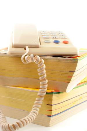 home telephone on top of phone directories photo