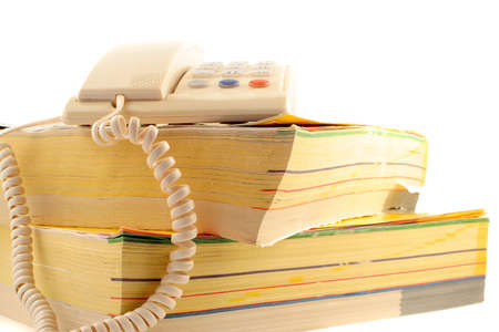 home telephone on top of phone directories