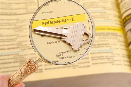 listings: looking for real estate listings in the phone book Stock Photo