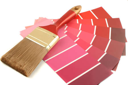 home decorating: red shade paint swatches, and small roller brush for home decorating