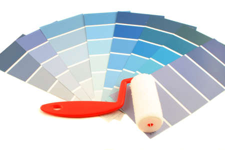 home decorating: blue shade paint swatches, and small paint roller for home decorating