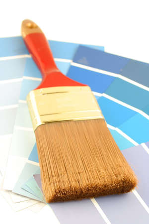 home decorating: blue shade paint swatches, and  paint brush for home decorating