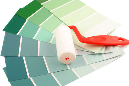 hues: green shade paint swatches, and small paint roller for home decorating Stock Photo
