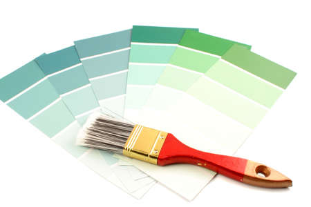 saturation: green shade paint swatches, and small paint roller for home decorating Stock Photo