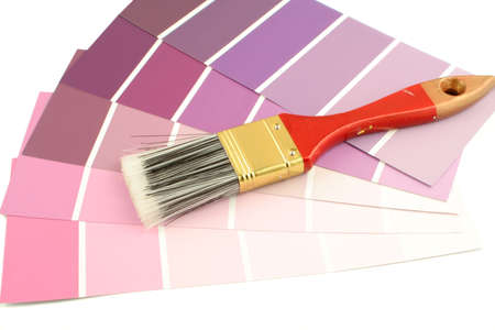 home decorating: purple shades paint swatches, and small paintbrushr for home decorating Stock Photo