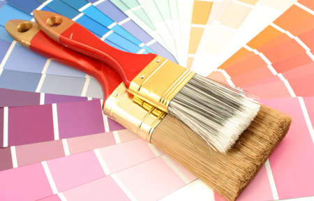 home decorating: rainbow paint swatches, and paint brushes for home decorating Stock Photo