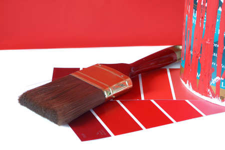 saturation:  paint swatches, and  paintbrush and red paint can for home decorating Stock Photo