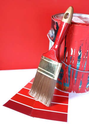 home decorating:  paint swatches, and  paintbrush and red paint can for home decorating Stock Photo